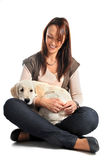 Puppy golden retriever and woman Stock Image