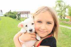 Puppy holded in kids hands Royalty Free Stock Images