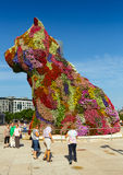 Puppy by Jeff Koons in front of  Guggenheim Museum. BILBAO, SPAIN - JULY 4, 2015: Puppy by Jeff Koons in front of  Guggenheim Museum in Bilbao Royalty Free Stock Photo