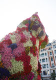 Puppy from Jeff Koons outside Guggenheim Museum, Bilbao, Spain. A view of the scuplture in flowers from Jeff Koons in the entrance square of Guggenheim Museum in Stock Image