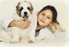 Puppy and kid Royalty Free Stock Photos
