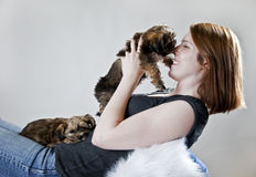 Puppy kisses Stock Images