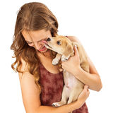 Puppy Kissing Laughing Girl Royalty Free Stock Photography