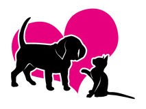 Puppy and kitten on the background of magenta heart Royalty Free Stock Photo