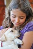 Puppy labrador retriever and little girl. Purebred puppy labrador retriever  and smiling little girl Royalty Free Stock Photos