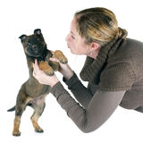 Puppy malinois and woman. In front of white background Royalty Free Stock Photography