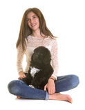 Puppy newfoundland dog and teen stock images