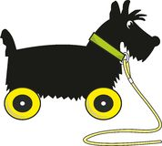 Puppy scotch terrier - toy on wheels Royalty Free Stock Image