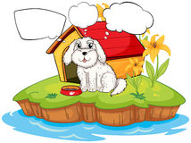 A puppy thinking near a doghouse Royalty Free Stock Photo