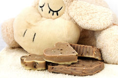 Puppy toy sleaping near homemade soap Stock Image
