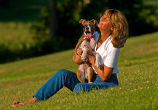 Puppy and woman smiling Stock Image