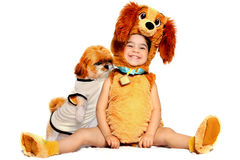 Puppylove. 20 month old toddler posing in a puppy costume with her puppy shihtzu Royalty Free Stock Image
