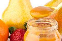 Purè e frutta del bambino Immagini Stock