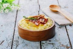 Purée de pommes de terre avec le lard image stock