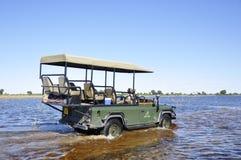 Pur приключения & Adrenalin: Okavango-перепад заболачивает скрещивание с a стоковое изображение