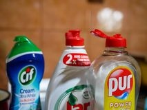 Pur, Jar and Cif diswhashing liquids in row on the kitchen sink. Miercurea Ciuc, Romania- 30 May 2019: Pur, Jar and Cif diswhashing liquids in row on the stock photography
