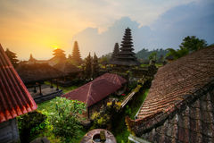 Pura. Yard with green trees and buildings of indonesian old temple Pura Besakih at sunset light. Bali. HDR image
