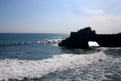 Pura Batu Bolong. Silhouette of Batu Bolong Temple, on a rock next to the famous Tanah Lot Temple in Bali, Indonesia Stock Image