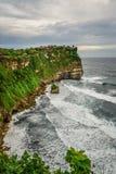 Pura Luhur Uluwatu temple. Bali, Indonesia. Amazing landscape - cliff with blue sky and sea Royalty Free Stock Image