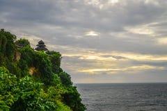 Pura Luhur Uluwatu temple. Bali, Indonesia. Amazing landscape - cliff with blue sky and sea Stock Photo