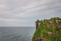 Pura Luhur Uluwatu temple. Bali, Indonesia. Amazing landscape - cliff with blue sky and sea Stock Photography