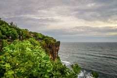 Pura Luhur Uluwatu temple. Bali, Indonesia. Amazing landscape - cliff with blue sky and sea Royalty Free Stock Images
