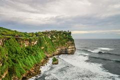 Pura Luhur Uluwatu temple. Bali, Indonesia. Amazing landscape - cliff with blue sky and sea Stock Photos