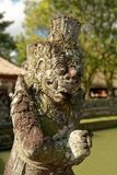 Pura Taman Ayun Statue. Pura Taman Ayun is a compound of Balinese temple and garden with water features located in Mengwi subdistrict in Badung Regency, Bali Royalty Free Stock Photo
