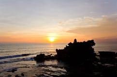 Pura Tanah Lot silhouette during sunset on Bali Stock Photos
