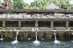 Pura Tirtha Empul, Bali, Indonesia. Holy spring water in temple pura Tirtha Empul inTampak, one of Bali`s most important temples, Indonesia stock photography