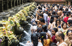 Pura Tirtha Empul, Bali, Indonesia. People praying at holy spring water temple Pura Tirtha Empul during purification ceremony in Tampak Siring, Bali, Indonesia Stock Image