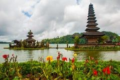 Pura Ulun Danu Batur temple in lake with flowers. Bali, Indonesia. Royalty Free Stock Images