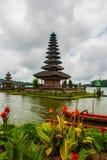 Pura Ulun Danu Batur temple in lake with flowers. Bali, Indonesia. Royalty Free Stock Photos