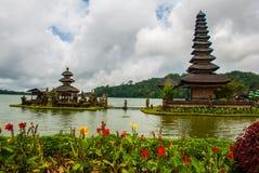 Pura Ulun Danu Batur temple in lake with flowers. Bali, Indonesia. Royalty Free Stock Photography