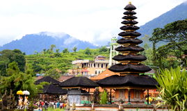 Pura ulun danu beratan. Tourists and some local resitents around the ulun danu temple at bratan lake, bedugul, bali indonesia Royalty Free Stock Photos