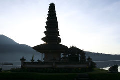Pura Ulun Danu water temple lake brataan bali. Pura Ulun Danu water temple silouette at dawn on lake brataan near bedugal, bali, indonesia Stock Photo