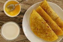 Puran Poli is a sweet flatbread made during special occasions or festival season. This bread is stuffed with sweet lentil stuffing and served with dollop of Royalty Free Stock Images