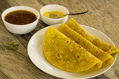 Puran Poli is a sweet flatbread made during special occasions or festival season. This bread is stuffed with sweet lentil stuffing and served with dollop of Stock Photos