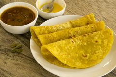 Puran Poli is a sweet flatbread made during special occasions or festival season. This bread is stuffed with sweet lentil stuffing and served with dollop of Royalty Free Stock Photography