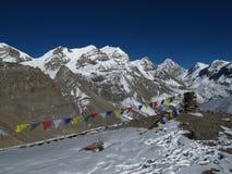 Purbung Himal and prayer flags Stock Image