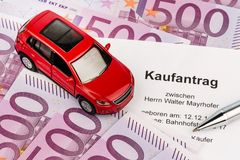 Purchase agreement for car. A purchase contract to buy a car at the car dealer. new and used cars stock images