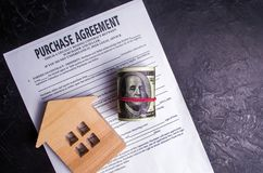 Purchase agreement. The concept of buying a home, real estate, apartment. Services realtor and real estate agent. Sale / sold hous royalty free stock image