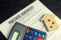 Purchase agreement. The concept of buying a home, real estate, apartment. Services realtor and real estate agent. Sale / sold hous. E. selective focus royalty free stock images