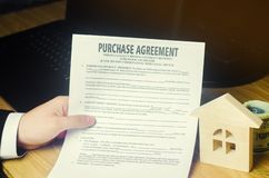 Purchase agreement. The concept of buying a home, real estate, apartment. Services realtor and real estate agent. Sale / sold hous royalty free stock images