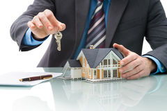 Purchase agreement for house. Man signs purchase agreement for a  house Stock Photo