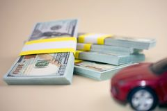 Purchase auto dealership and rental car. Car loan buying a new car concept. red car money royalty free stock photography
