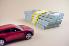 Purchase auto dealership and rental car. Car loan buying a new car concept. red car money stock images