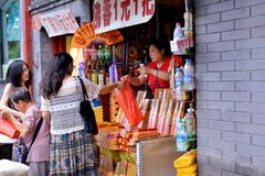 Purchase of buddhist incense Stock Photos