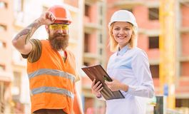 Purchase of building materials. Construction industry. Foreman established supply of building materials. Expert and. Builder communicate about supply building royalty free stock image