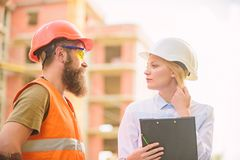 Purchase of building materials. Construction industry. Successful deal concept. Foreman established supply of building. Materials. Expert and builder stock images